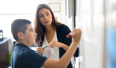 Lucia Cordovano with student at whiteboard