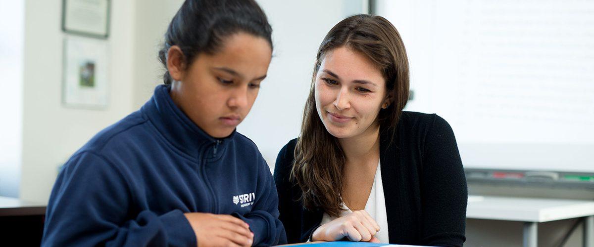 Lucia Cordovano helping grade-school student