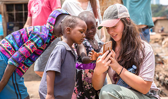 CAM student with Ugandan children
