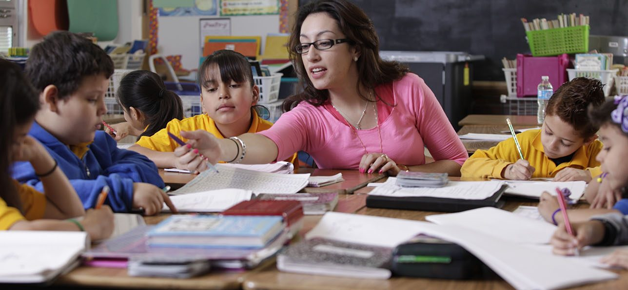 SEHD undergraduate woman in classroom teaching children