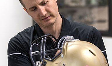 Professor Chris Yakacki and football helmet