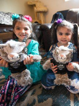 Children with mascot dolls