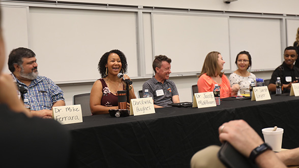 Event panelists in Student Commons Building lecture hall