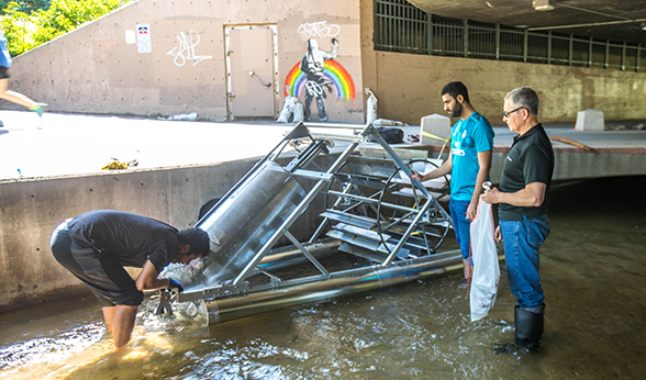 Checking trash removal device in Cherry Creek