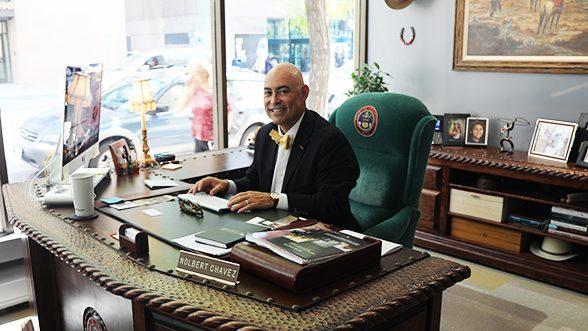 Nolbert Chavez at desk