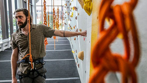 Dyer stands by climbing wall