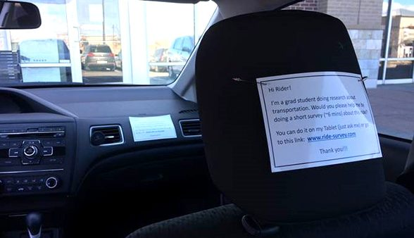 Note on back of seat asking rider to complete a survey.