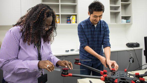 Engineering students work in lab