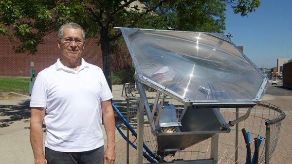 Researcher with solar heat generator