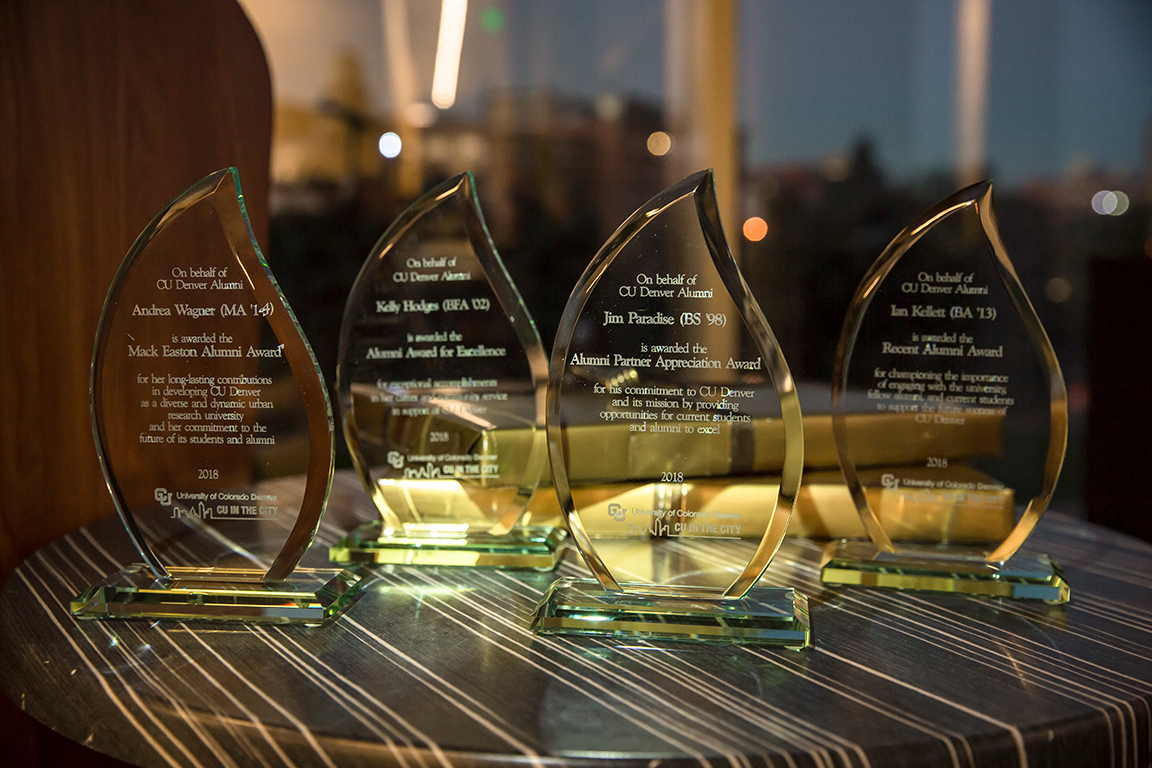 Four glass awards on a table