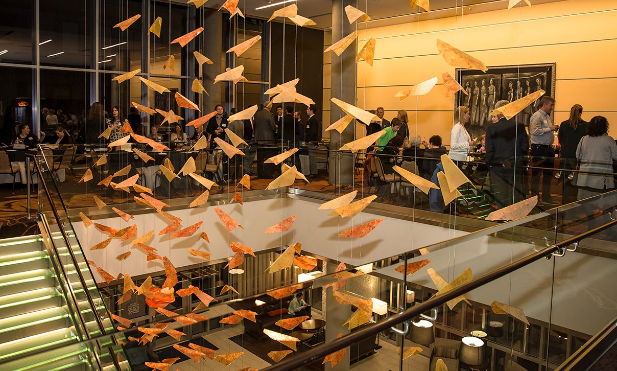 Paper birds hang from ceiling in the Wright Room