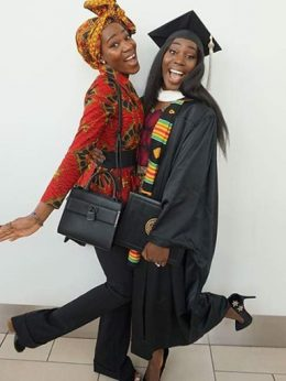 Two women hugging at graduation