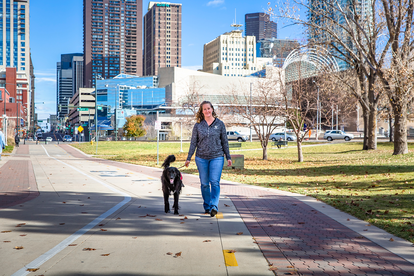 Student walking on campus with dog