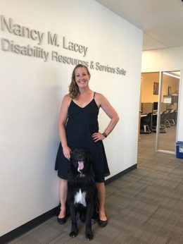 Woman with service dog in office
