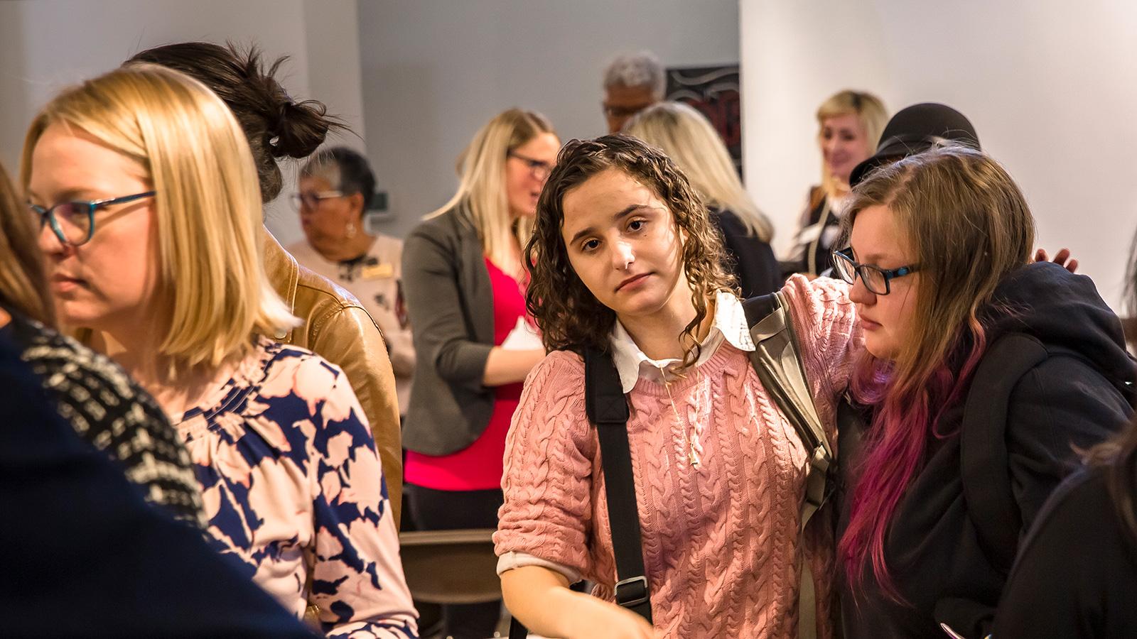 Students mingle at community gathering