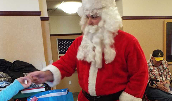 Santa hands out gifts