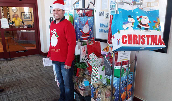 Volunteer with pile of gift