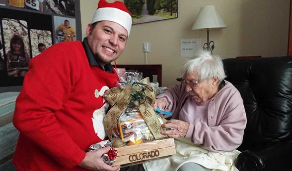 Volunteer brings gift to room-bound vet.