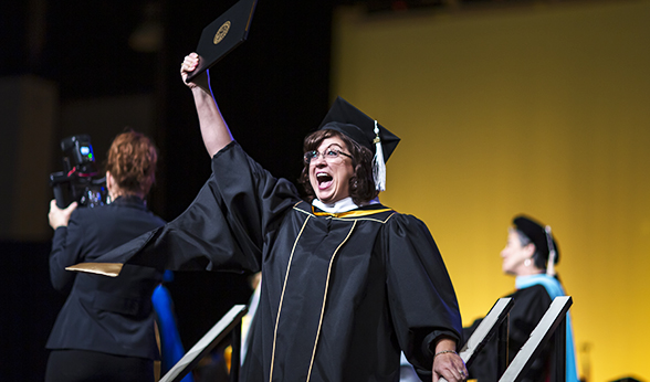 Grad holds up degree