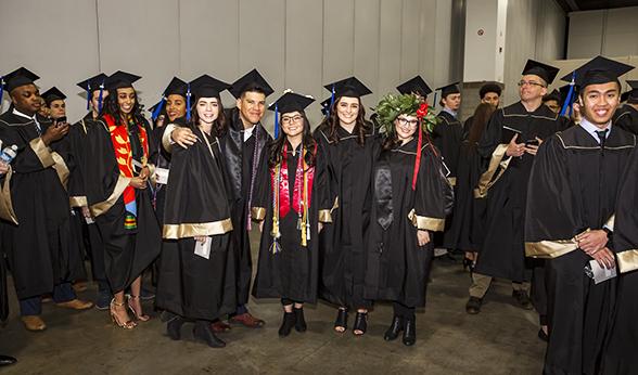 Happy graduates in a line