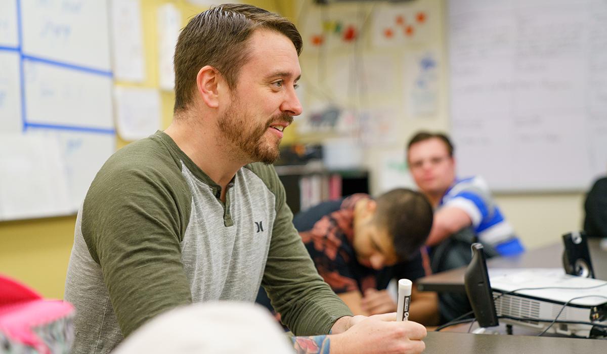 Brian Thomas at desk