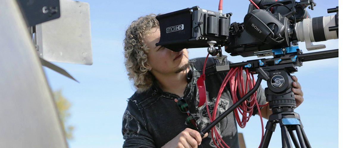 Ian Kellett looks through video camera
