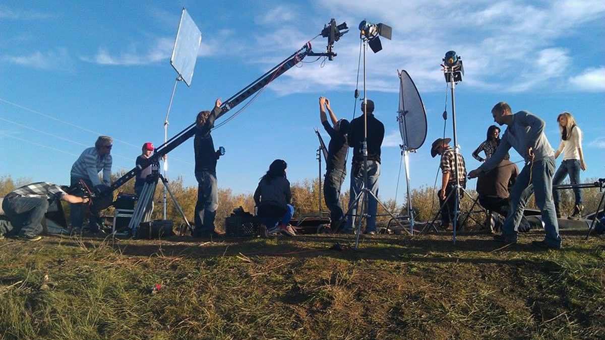 Film crew sets up in field