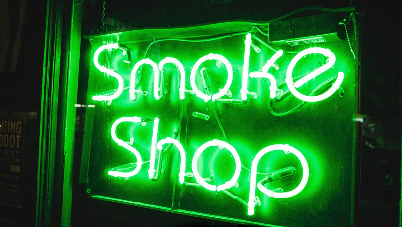 "Neon green ""Smoke Shop"" sign"