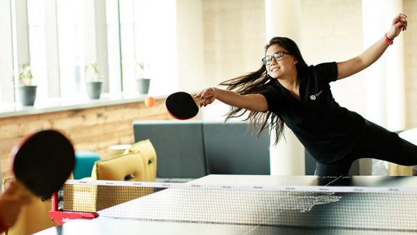 Young woman playing table tennis