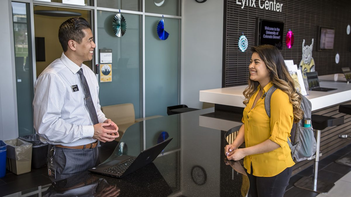 Celia Lopez talks with the Lynx Center director in the Student Commons Building