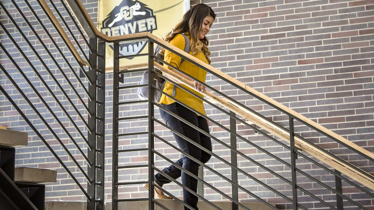 Student Celia Lopez walks down the stairs