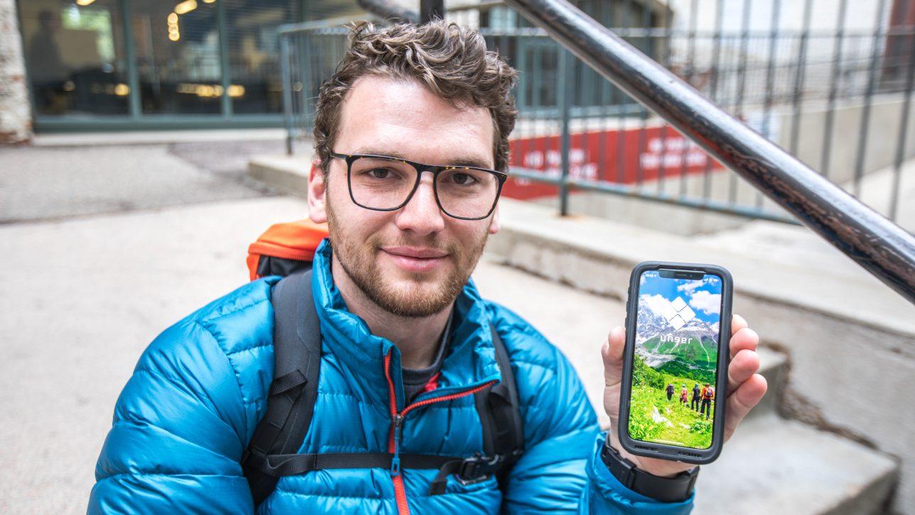 Alex Fletcher shows off his app, Unser