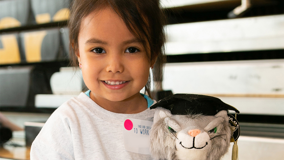Child with Milo the Lynx doll