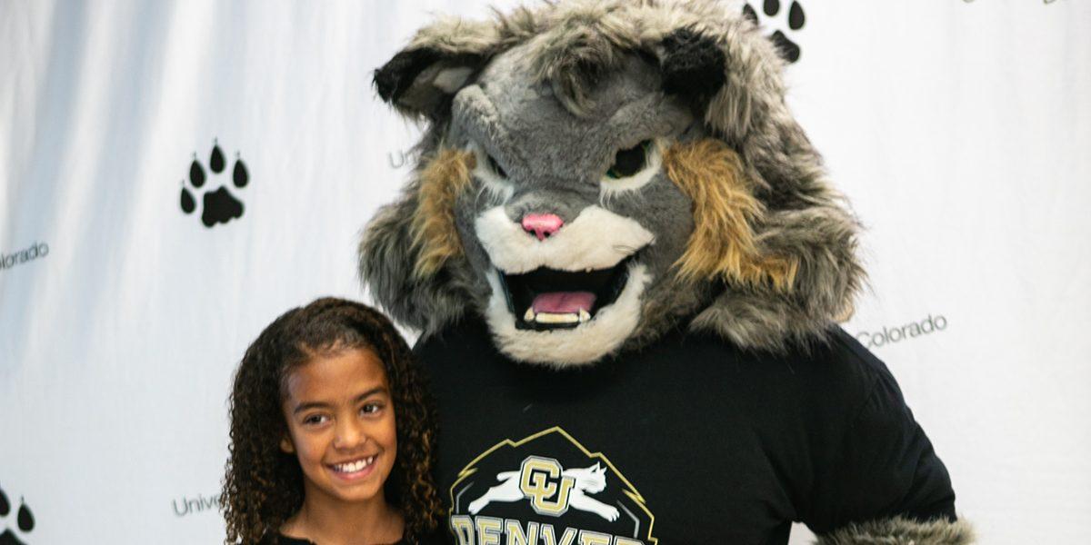 Milo the Lynx with a kid.
