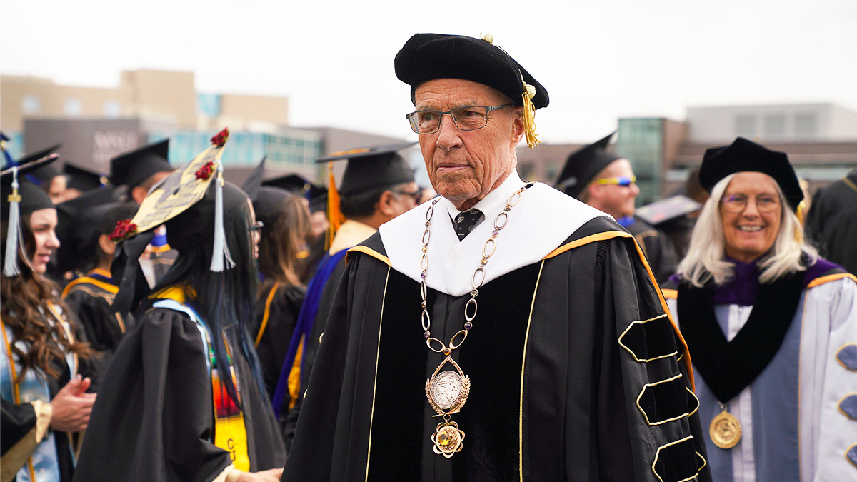 President Benson makes his way to the commencement stage.