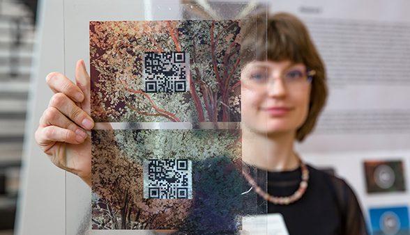 Livy Snyder holds framed barcode