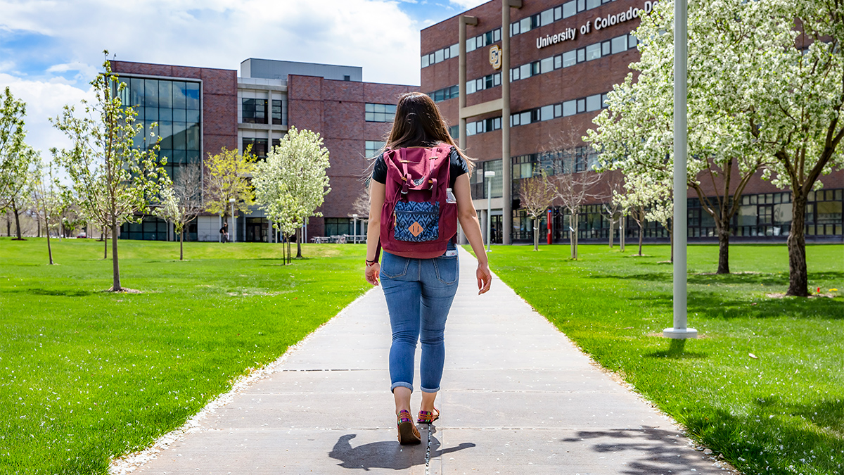 Cynthia Rojo walks towards CU Denver campus.