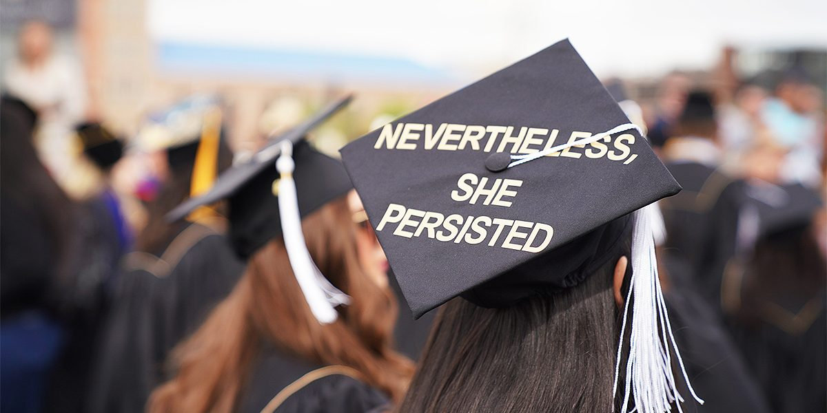 """Female graduate's cap with quote """"Nevertheless, she persisted""""."""