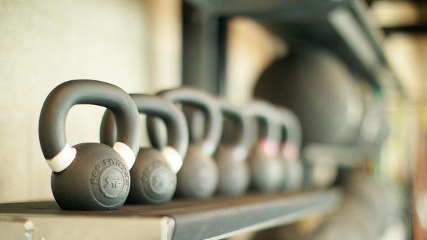 Kettle bells on a shelf in a row