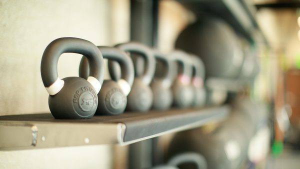 Kettle bells on a shelf in a row