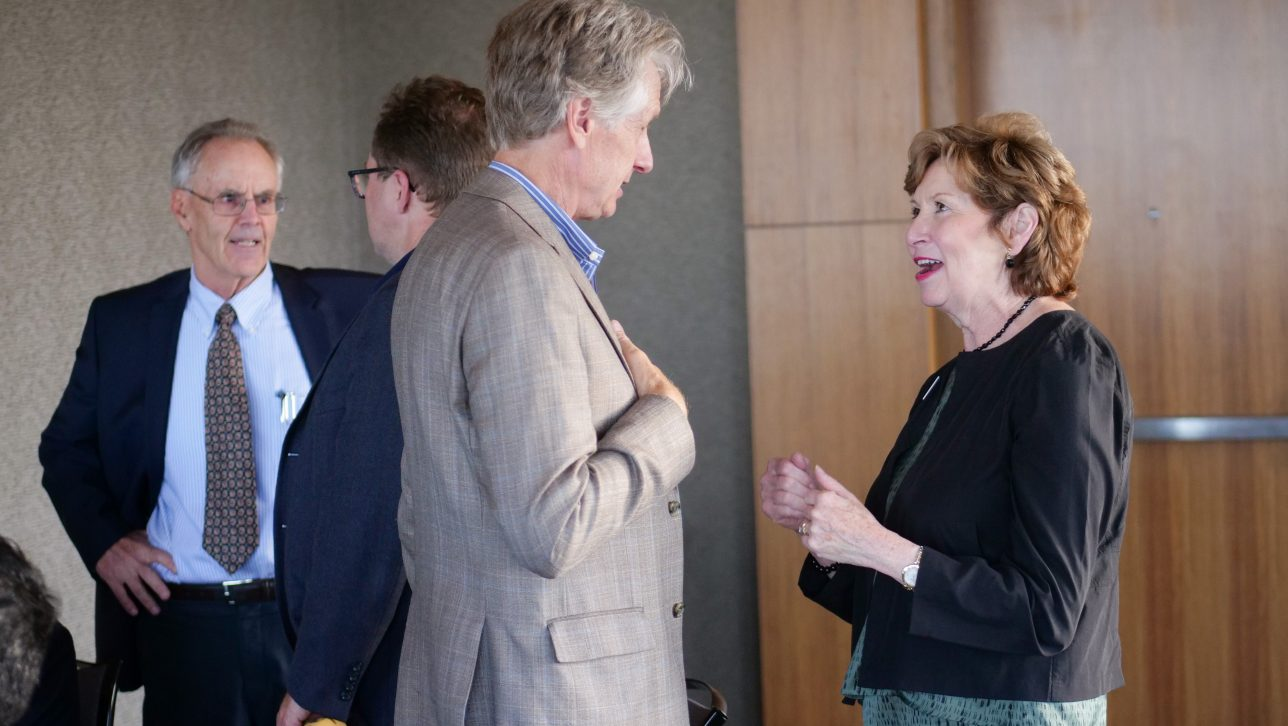 Chancellor Horrell mingles with Symposium attendees.