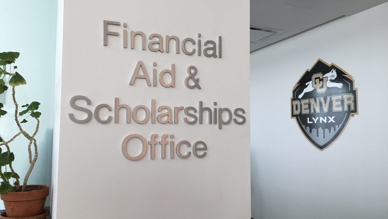Picture of the entrance to the Financial Aid & Scholarship Office. Sign with text and a CU Denver logo