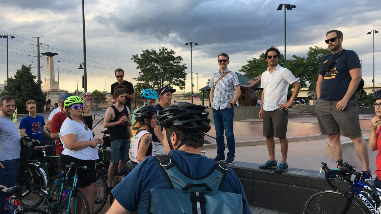 Image shows Fertig talking to cyclists at the August 2 Critical Mass ride he organized