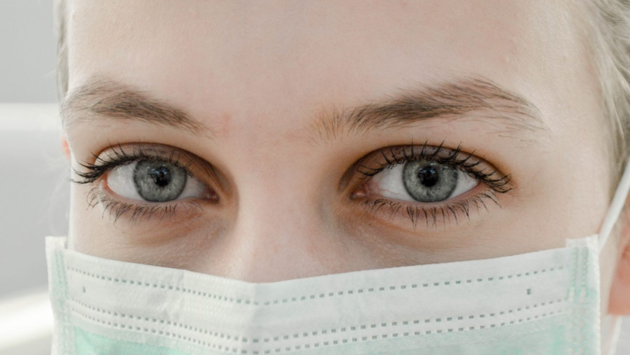Close-up of woman with a medical mask on.