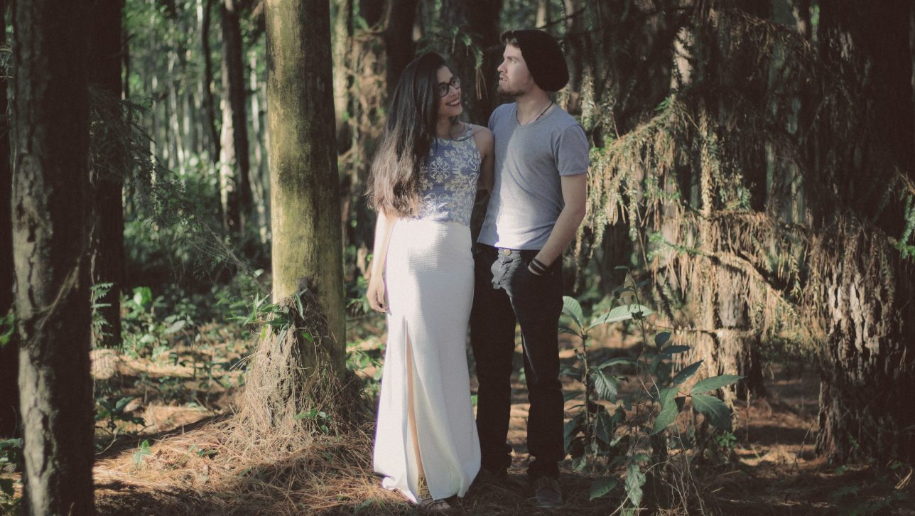 photo of young couple in forest. Photo by Allef Vinicius on Unsplash