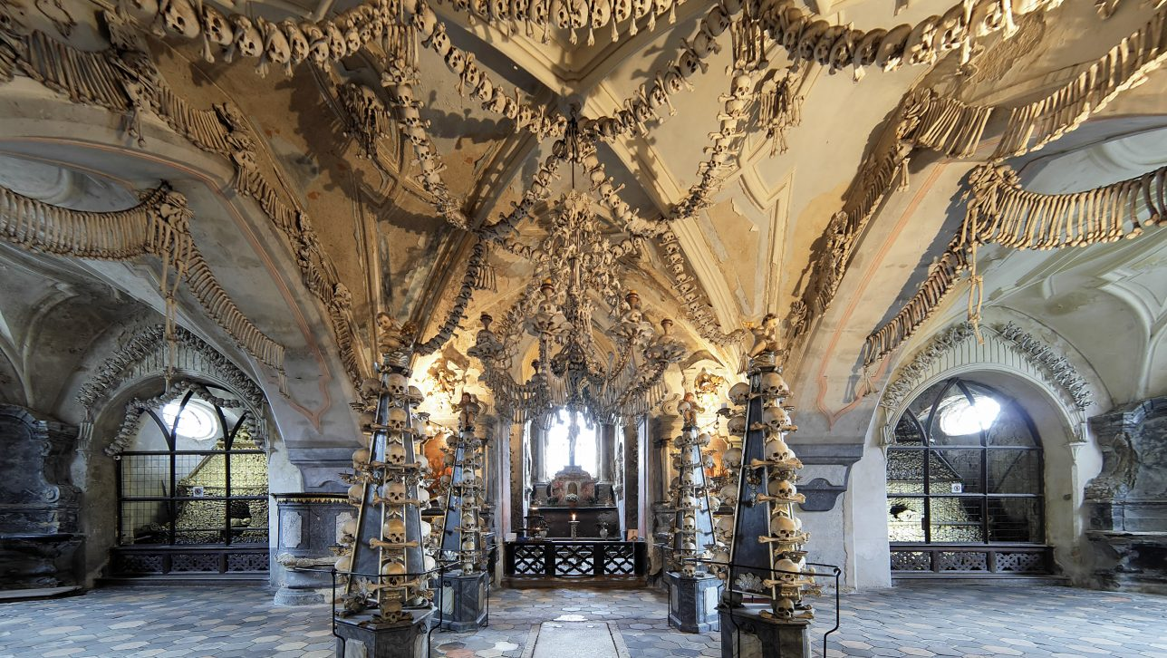 Sedlec Ossuary in Czech Republic displays bones in artistic compositions, including a huge chandelier.