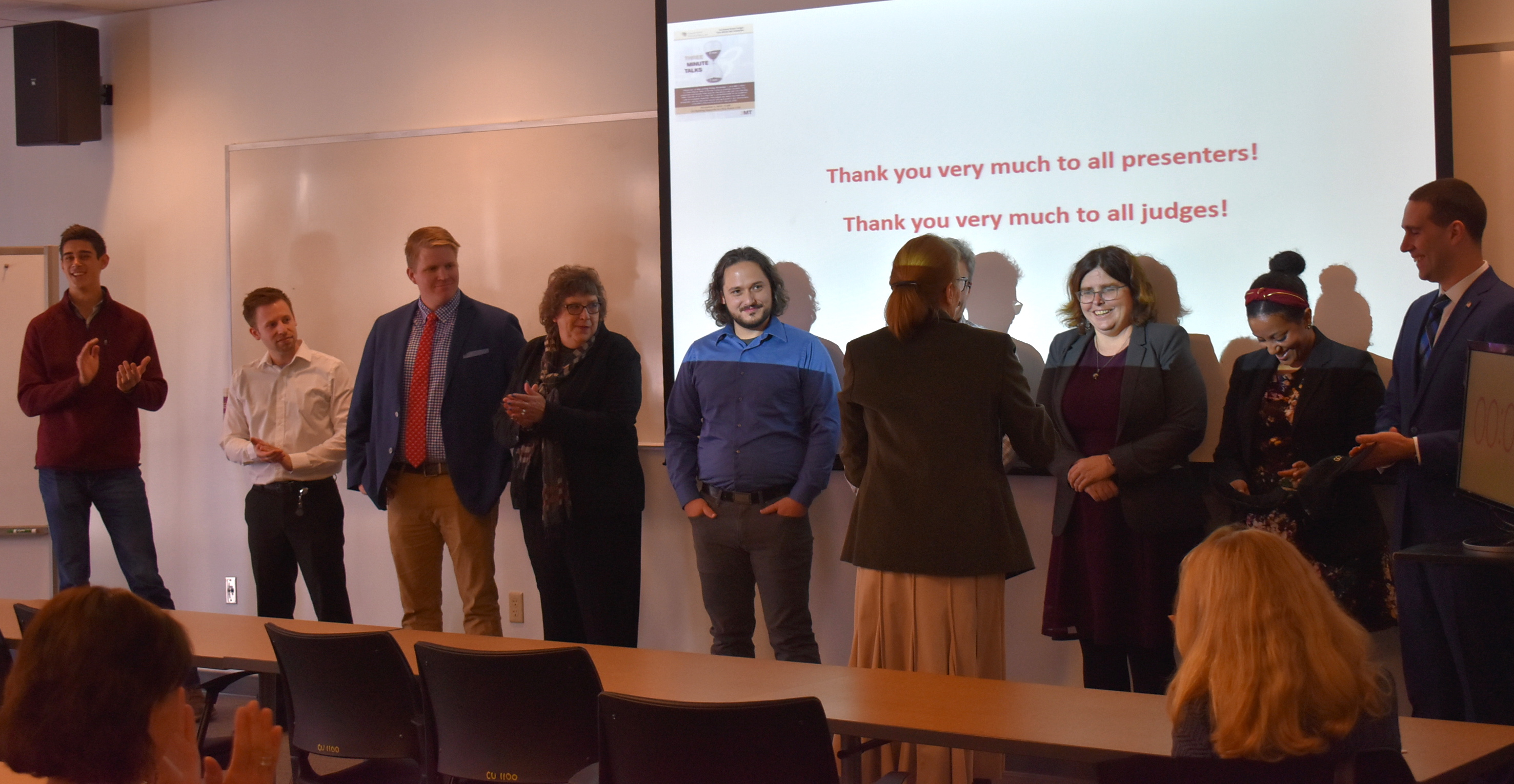 The nine competitors who participated in this year's Three-Minute Talk competition.