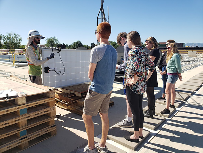 Auraria Campus students on the Auraria Library learning about the solar panels.