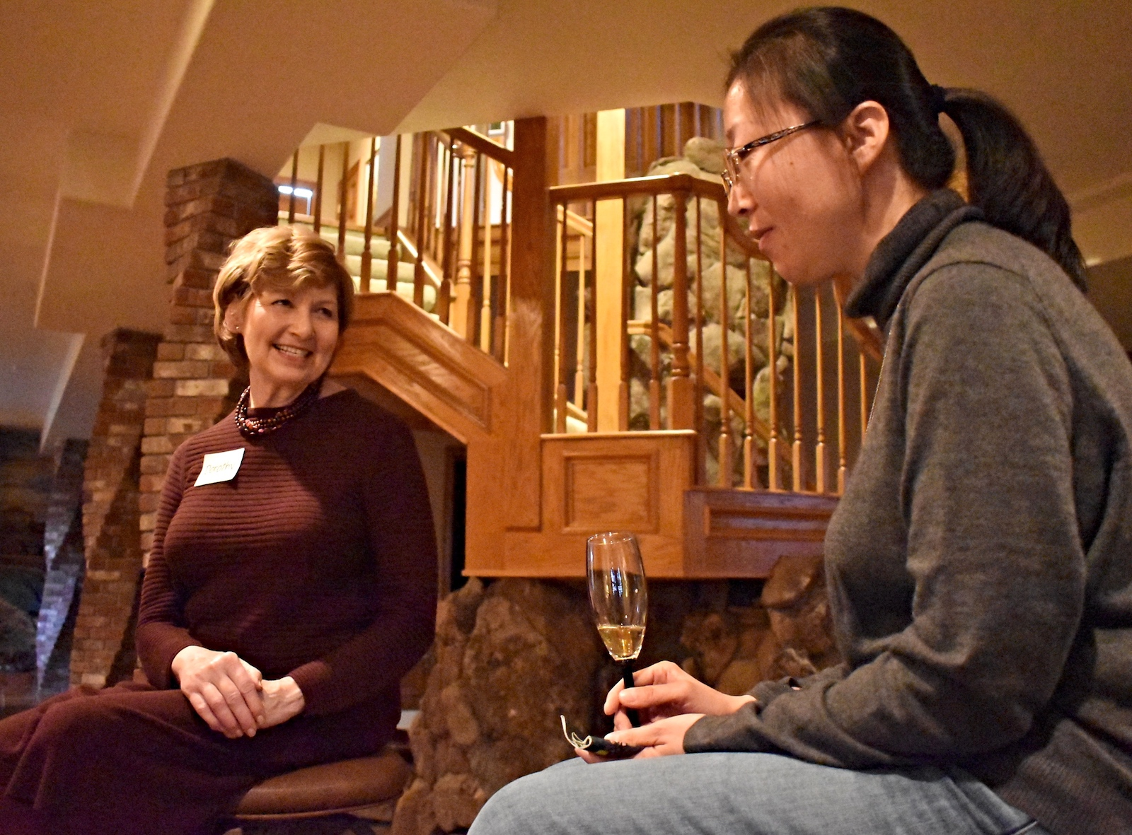Chancellor Dorothy Horrell talks to a student at a meal hosted as part of CU at the Table.