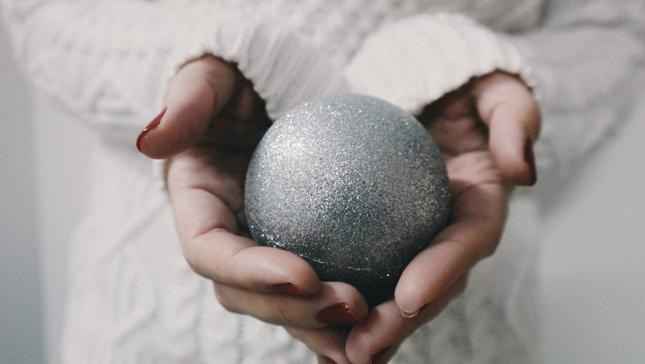 hands holding ornament-photo by brigitte tohm via Unsplash